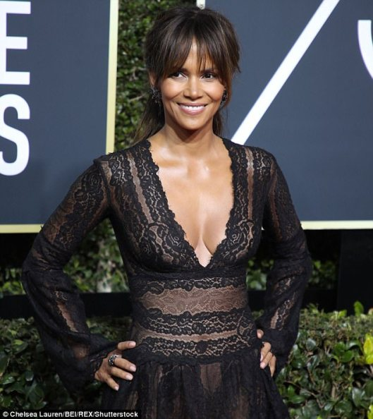 Halle Berry-emeralds on her hand, emerald-colored crystal earrings from Swarovski